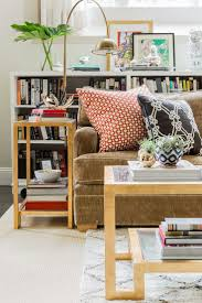 Decorating Bookshelves In Family Room by 25 Best Bookcase Behind Sofa Ideas On Pinterest Room Divider