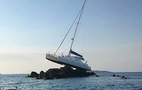 catamaran stranded on a reef in kimberley region wa daily mail