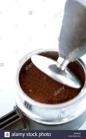 Freshly Ground Coffee In A Grinder Holder Being Pressed Down Ready To Make Fresh Or Espress