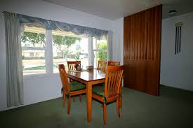Dining Area And Original Doorbell On The Wall Near Front Entrance
