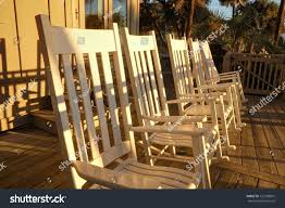 Low Angle Rocking Chairs On Deck Stock Photo (Edit Now) 122708815 ... Adams Mfg Corp Stackable Resin Rocking Chair At Lowescom Chairs Naturefun Outdoor Patio Rocker Balcony Glider Garden And Front Porch Tour Our House Now A Home 10 Best 2019 Living Old Stock Image I2788425 Featurepics Antique Wicker Barrel Cracker Porch Nur Deck Splendid Gracie Oaks Rajesh Reviews Wayfair 11 Rockers For Your Black The Depot Off The A Brief History Of One Americas Favorite