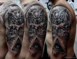 Black And Grey Owl With Illuminati Eye Tattoo On Man Left Half Sleeve