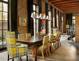View In Gallery Chairs Add A Touch Of Yellow To The Industrial Dining Room Design Wells
