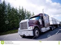 100 Bad Trucks Big Rig Semi Truck With Lumber Cargo On Flat Stock Photo Image