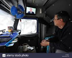 Ryazan, Russia. 3rd Dec, 2015. A Truck Driver Watches A Live TV ... Average Truck Driver Salary How Much Do Drivers Make You Drive A Truck United States Driving School Killed In Headon Crash Ionia County Other News Us To Mandate Elogs What Shapes The Life Of Trucker Protect Your Sight The Best Sunglasses For Eagan Driver Dies Fatal Crash West Australian Losing Weight As Alltruckjobscom New Ontario Drivers Receive Mandatory Traing Toronto Star Cris No Qualified Truckerdesiree Leg Amputated Semi Injured Fourth July Pas Distracted Driving Safety Advocates Call Culture Shift