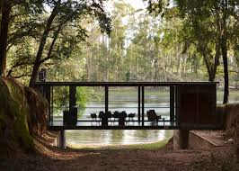 House Suspended Across A Ravine In A Eucalyptus Forest