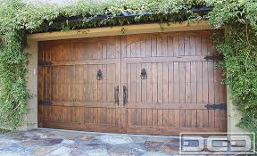 Tuscan Garage Door Made In Solid Wood Decorated With Iron HardwareBeautiful Old World Style Handcrafted Alder Which Offers A Rustic