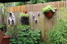 Rustic Wooden Fence Decorations With Natural Green Indoor Plant And Chic Accessory Suitable To Cute Garden