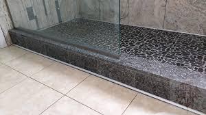 build a granite shower curb with a prefab granite backsplash