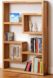 Basic Wood Shelf Design by This Custom Designed Shelf System Is Used To Store Books And Act