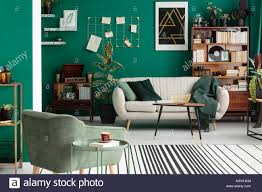 beige sofa and green armchair in living room