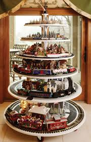 Carl Built This Six Tier Tree Train One Year To Show Off His Collection The Trains Race Along Track Which Surrounds Other Holiday Decor