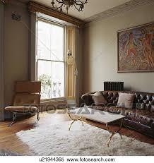 braun leder chesterfield sofa und metall gerahmt