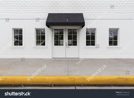 White Storefront Building Black Awning Stock Photo 376240120 ... How To Build A Patio Cover Must Watch Awnings Dubai Commercial Portfolio Otter Creek Business Sioux Falls Sd Metal Building Awning Suppliers And Buildawnings Cs Canopy Best 25 Porch Awning Ideas On Pinterest Portico Entry Diy Timber Frame Heavy Timbered Kansas City Bakerlockwood Western Company Lehrman Canopies Windows Treatments Call Simple Frame With Kee Klamp Fittings Projects To Residential Greenville Neon Nc Eastern