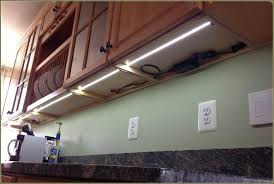 cabinet lighting with power outlets angled home design
