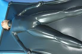girl in vacbed made from metallic pewter latex Latex