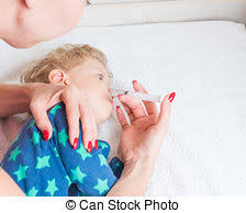 bulb syringe to clean baby s nose using bulb stock