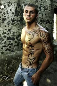 Black Ink Tribal Tattoo On Chest And Arm For Guys