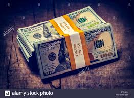 Stacks of new 100 US dollars 2013 banknotes bills Stock
