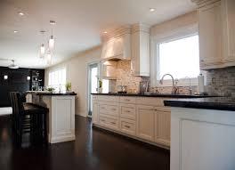 Kitchen Backsplash Wood Floors Pendants Black Countertops White Cabinets