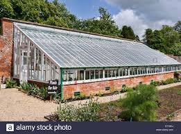 100 Glass Walled Houses Large Glasshouse In A Walled Garden In Wiltshire UK Stock