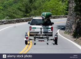 A Park Ranger Truck On A Winding Road With A Canoe On A Roof Rack ... View Diy Canoe Rack For Pickup Truck Howdy Ya Dewit Easy Homemade Changes Kayak How To Transport Large Kayaks Take Down Canoegear Youtube Does Anyone Else Haul A Kayak Toyota Tundra Forum To Short Bed Suv And Some Cars Best Racks For Trucks Roof Safely Transporting Your Paddle Pursuits Big Foot Pro Carrier Instructables 7 Inimotorkucom On The Pup Roof Rack Advice Wanted Pupportal Fishing Sweet Stuff Oak Orchard Experts Pick Up Rear Kayaks