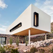 100 Mountain House Designs Volcanic Stone Contrasts With White Stucco At Texas Desert Home By