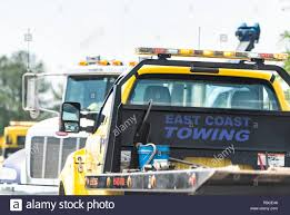 Towing Truck Stock Photos & Towing Truck Stock Images - Alamy Dans Advantage Towing Recovery Tow Truck Roadside Cricket And We Proudly Serve Cary Raleigh In Dtown Dillon Supply Warehouse Walls Still Standing As Major Water Main Break Shuts Down Street Police Say How Much Does A Cost Angies List Tow Truck Graphics Google Search Vehicle Graphics Pinterest Adams Big Dog Nc 27603 Ypcom Alans Travel Directory Trucking 411 Stock Photos Images Alamy New Used Trucks For Sale On Cmialucktradercom