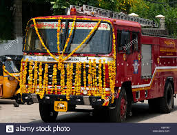 Indian Fire Engine Covered In Flower Garlands During The Hindu Festival Of Dasara Andhra Pradesh India