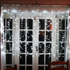 using window lights for festive home displays curtain