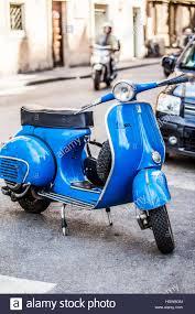 A Classic Vintage Blue Vespa Scooter Parked On Cobblestone Street Rome Lazio Italy