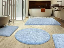 Modern Bathroom Rugs And Towels by Bahtroom Casual Bathtub And Brown Towel Hanging On Edge Closed