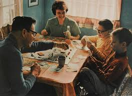 Vintage Family Playing Board Game At Table