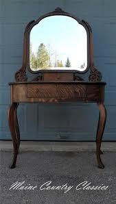 antique quartersawn tiger oak vanity with beveled mirror locking