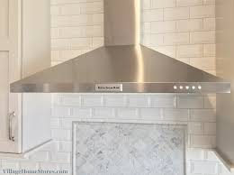 kitchenaid stainless chimney style and carrara marble with