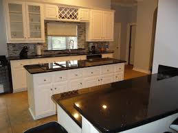 Love Black And White Kitchens Galaxy Granite Countertops With Painted Cabinets