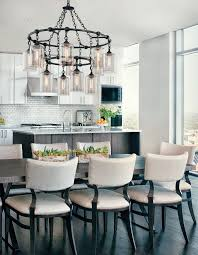 Wrought Iron Chandelier Over A Kitchen Table