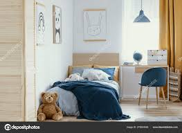 Desk, Chair And Single Bed With Blue Bedding In Cozy Bedroom ... Desk Chair And Single Bed With Blue Bedding In Cozy Bedroom Lngfjll Office Gunnared Beige Black Bedroom Hot Item Ergonomic Home Fniture Comfotable Chairs Wheels Basketball Hoop Chair Bedside Tables Rooms White Bedrooms And Small Hotel Office Table Desk Lamp Wooden Work In Stool Space Image Makeup Folding Table Marvellous Computer Set 112 Dollhouse Miniature 6pcs Wood Eu Student Main Sowing Backrest Solo Stores Seating Reading 40 Luxury Modern Adjustable Height