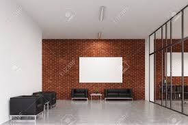 Office Waiting Area With White And Brick Walls There Are Square Armchairs Near A Coffee
