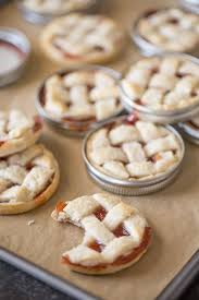 Buttery flaky pie crust with strawberry jam for filling baked inside a mason jar lid