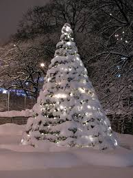 Prelit Christmas Tree That Puts Up Itself by Christmas Tree Covered In Snow And Lights Winterlicious