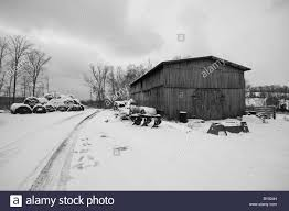 Winter Scene Of An Old Barn Next To A Farm Road, Both Covered In ... Old Barn Scene In Western Russia Rustic Farm Building Free Images Wood Tractor Farm Vintage Antique Wagon Retro With Silver Frame Urbamericana G Poljainec Acrylic Pating Winter Of Yard Photo Collection Download The Stock Photos Country Old Barn Wallpaper Surreal Scene Dance Charlotte Joan Stnberg Art Scene Unreal Engine Forums