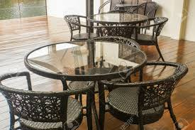 Close Up Wicker Chair With Round Table In Vintage Cafe