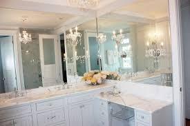 Chandelier Over Bathroom Vanity luxurious bathroom with white beadboard vanity cabinets and drop