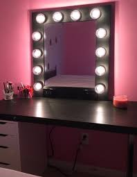 black wooden mirror frame with bulb lights of mirror with lights