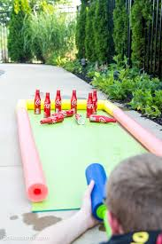 DIY Coke® Bottle Outdoor Bowling Game | Pool Noodles, Bowling And Coke 25 Tutorials For A Diy Carnival The New Home Ec Games 231 Best Summer Images On Pinterest Look At The Hours Of Fun Your Box Could Provide With Game Top Theme Party Games For Your Kids Backyard Lollipop Tree Game Put Dot Sticks Some Manjus Eating Delights Carnival Themed Birthday Manav Turns 4 240 Ideas Dunk Tank Fun Summer Acvities Outdoor Parties And Best Scoo Doo Images Photo With How To Throw Martha Stewart Wedding Photography By Vince Carla Circus