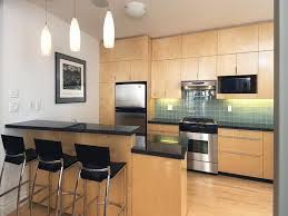Modern Triple Pendant Light Over Kitchen Island Bar And Built In Cabinetry Storage