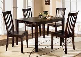 Hyland Rectangular Dining Table W 4 ChairsAshley