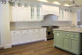 Simple Kitchen Design Using Square Light Green Wood Island Including White Granite