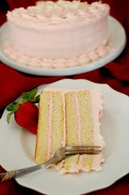 Easy moist white layer cake with fresh strawberry cream cheese frosting is perfect for a birthday